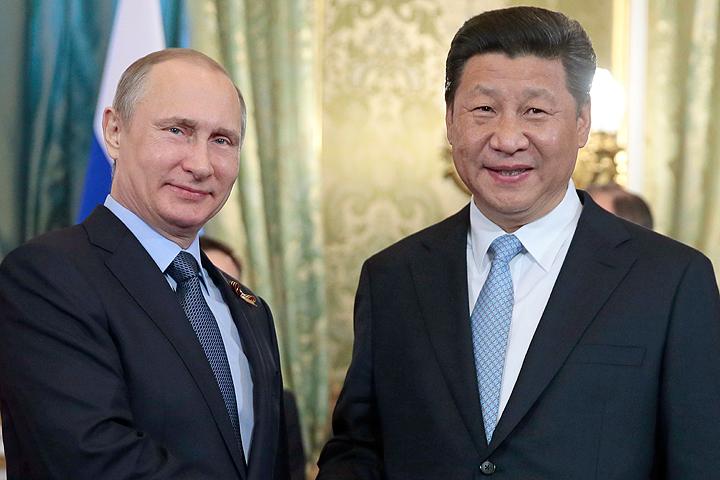 Президент России Владимир Путин и председатель КНР Си Цзиньпин. ФОТО Михаил Метцель/ТАСС