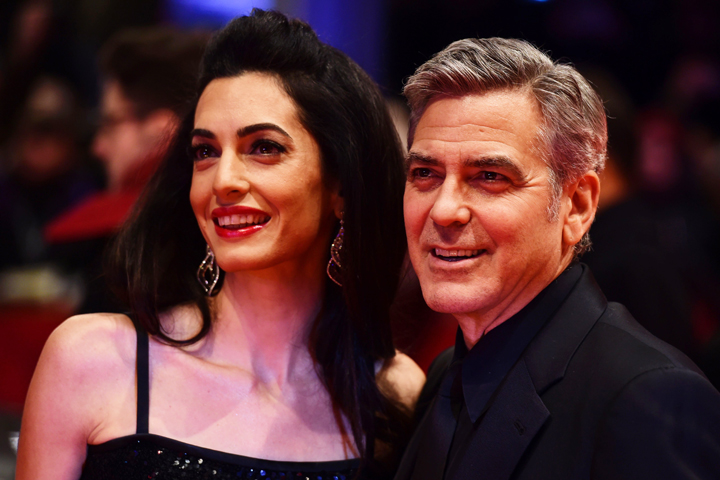 Джордж уверяет, что ему приятно побыть в тени своей красивой и умной жены. Фото: SPLASH NEWS