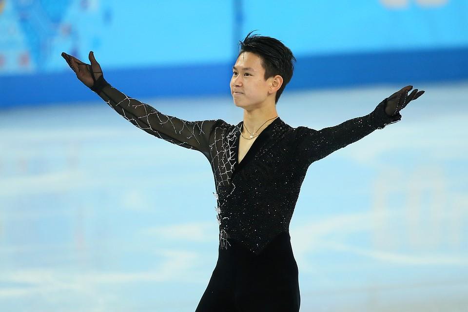 Денис Тен во время выступления в короткой программе на Олимпиаде в Сочи