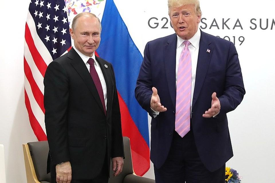 Президенты России и США Владимир Путин и Дональд Трамп на встрече в Осаке