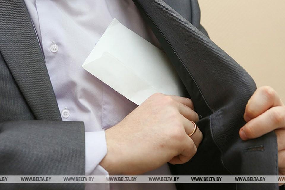 За зарплату в конверте вводится уголовная ответственность. Фото: БелТА