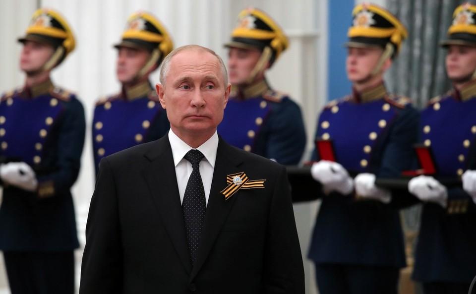 Президент Путин во время церемонии вручения государственных наград в Кремле.