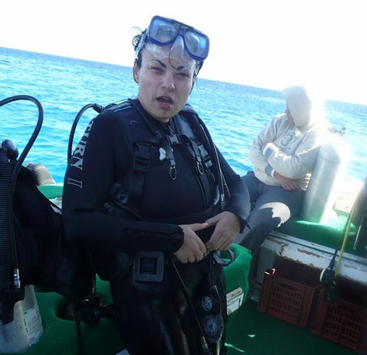 Ирина позируют с аквалангом. Фото с сайта www.burinfo.org.