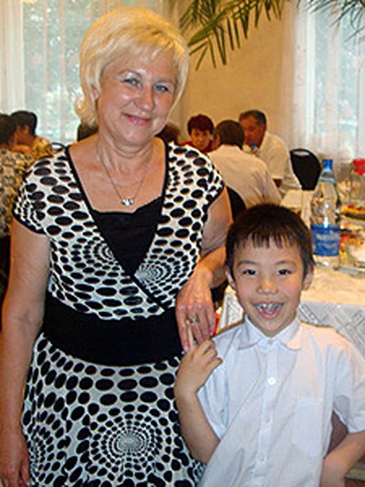 Румия со своим внуком Расимом.